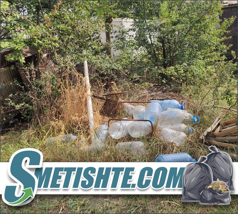 Почистване на двор с боклук, храсти и израстъци.